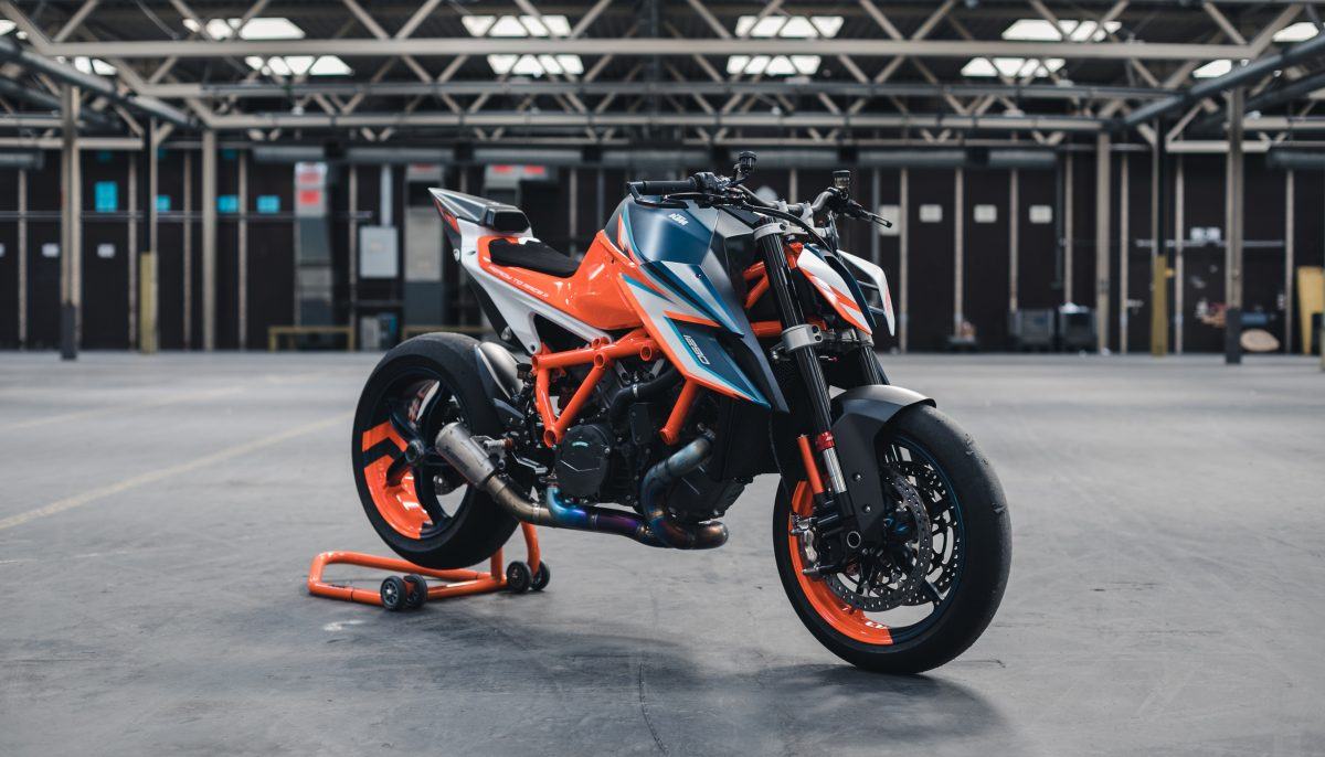 KTM 1290 Super Duke R front three quarter view in a warehouse