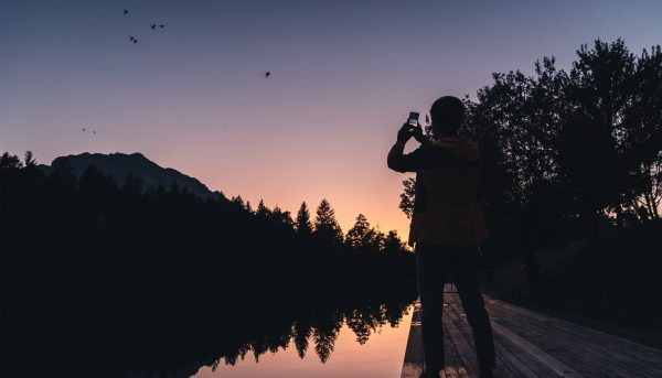 KISKA product management consultant after work taking photo of Austrian alpine lake
