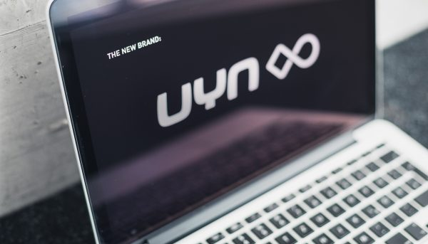 UYN communication design concept and website on a laptop